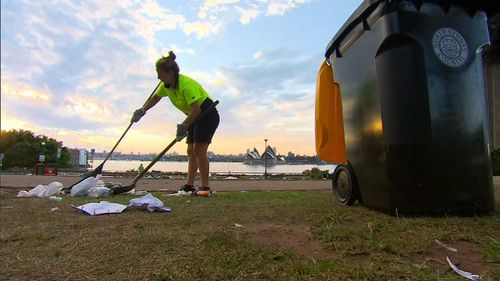 A council worker collects rubbish.