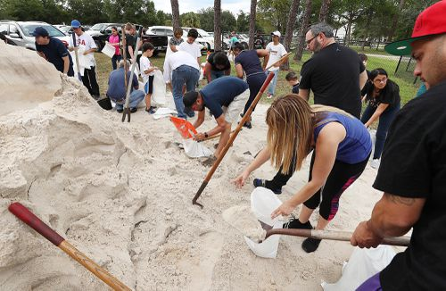 Sandbags are being offered in advance of Hurricane Dorian, which is forecast to likely hit Florida.