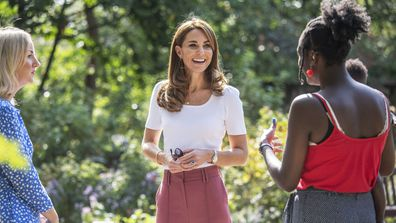 Kate Middleton, the Duchess of Cambridge, centre smiles, during a visit to Battersea Park, as she met up with mothers, in London, Tuesday, Sept. 22, 2020.