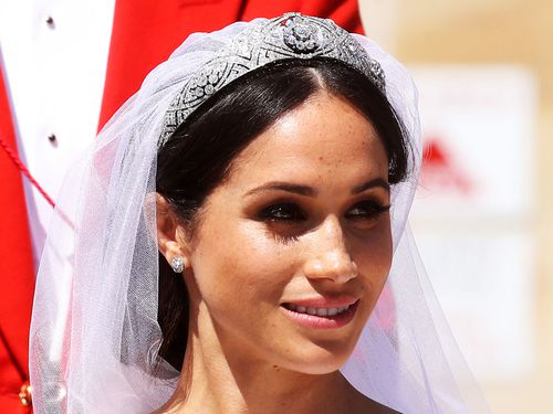 Holding Meghan's veil in place was Queen Mary's 1932 diamond and platinum bandeau tiara.