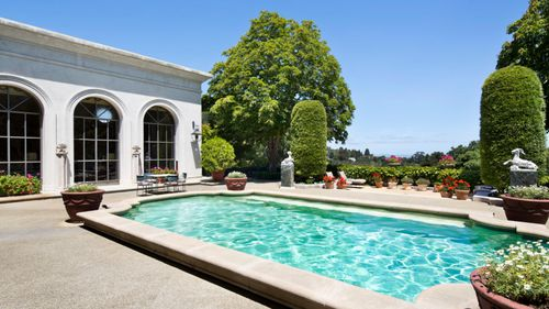 As well as a pool, the property has an eight-car carport as well as a wine and liquor cellar.