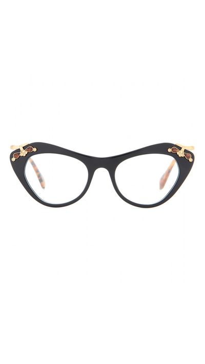 "<p><a href=""http://www.mytheresa.com/en-au/embellished-optical-glasses-389319.html?gclid=CPzc5cml-MUCFcSWvQodEQcAhg"" target=""_blank"">Embellished Optical Glasses, $415, Miu Miu</a></p>"
