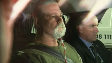 The man arrested and charged with the murder of Linda Reed is transported by police.