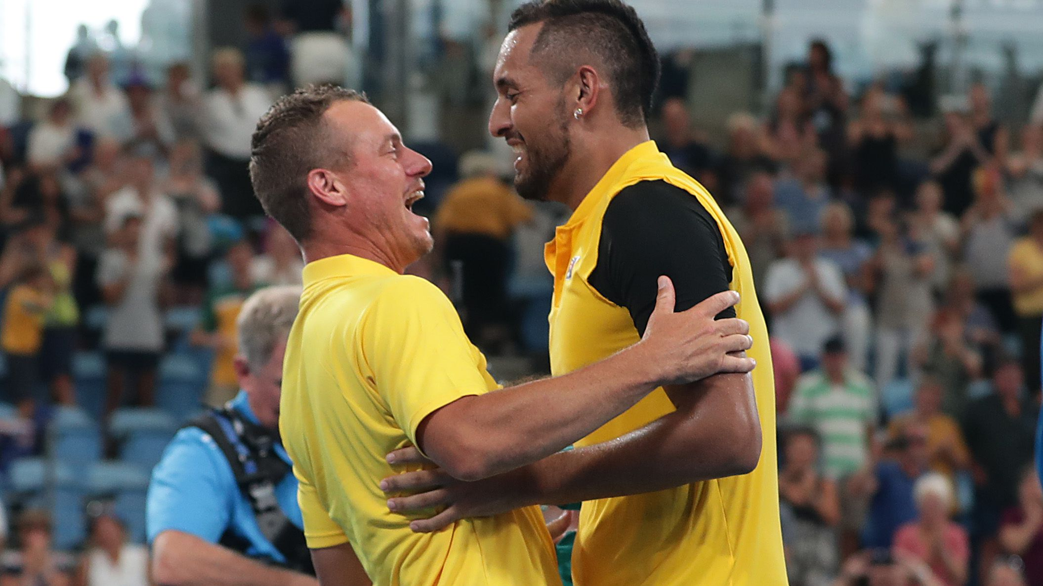 Lleyton Hewitt and Nick Kyrgios embrace during the ATP Cup.