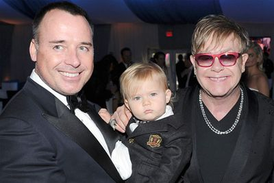 ...with partner David Furnish and their baby Zachary.