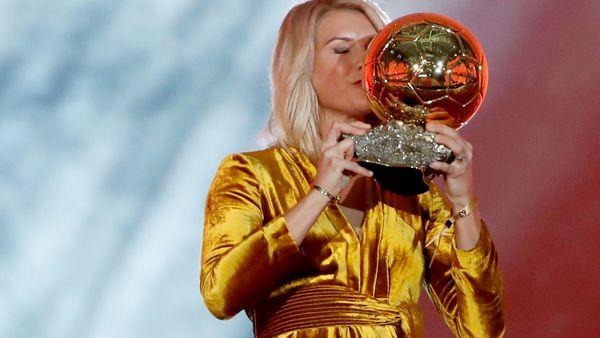 Olympique Lyonnais' Ada Hegerberg celebrates with the Women's Ballon d'Or award during the Golden Ball award ceremony at the Grand Palais in Paris.