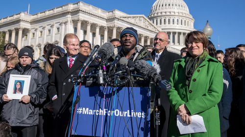 Student Robert Edwards speaks alongside lawmakers and gun control activists at the US Capitol in Washington, a day before the March for Our Lives movement rally. (AAP)