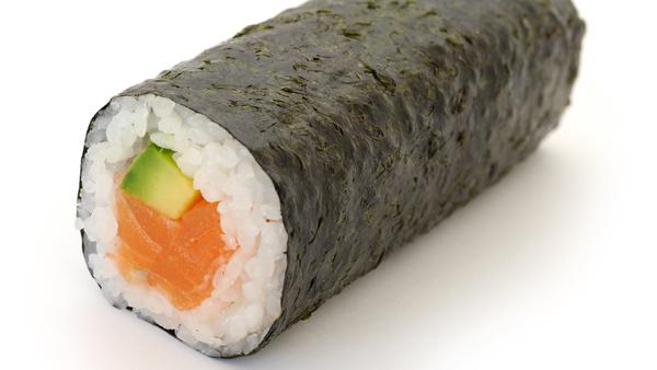 Salmon and avocado sushi roll stock image