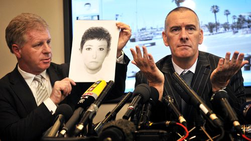 Taken in 2009, private investigator Dave Edgar with McCann spokesman Clarence Mitchell holding an e-fit of a 'Victoria Beckham lookalike' they believe may have information about missing Madeleine McCann. (Getty)
