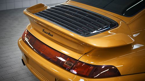 The 993 is air-cooled, necessitating the 'whale-tail' spoiler.