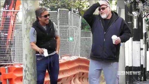 Despite looking relaxed with close friend and media personality Kyle Sandilands, John Ibrahim has demanded his lawyer challenge a firearms prohibition order. Picture: 9NEWS.
