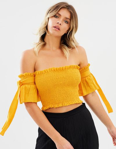 """<p><a href=""""https://www.theiconic.com.au/port-top-529419.html"""" target=""""_blank"""" draggable=""""false"""">Rue Stiic Port Top in Marigold, $139</a></p>"""