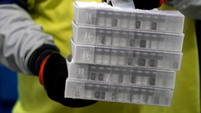 Boxes containing the Pfizer-BioNTech COVID-19 vaccine are prepared to be shipped at the Pfizer Global Supply Kalamazoo manufacturing plant in Portage, Michigan, Sunday, Dec. 13, 2020. (AP Photo/Morry Gash, Pool)