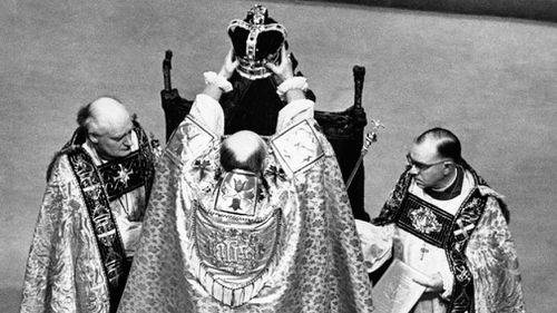 June 2, 1953: The Archbishop of Canterbury holds the ritual crown of England, the crown of St. Edward, over the head of Queen Elizabeth II, prior to the actual crowning at the coronation ceremony in Westminster Abbey, London. (AAP)