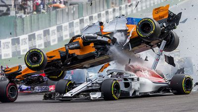 Fernando Alonso in a crash at the 2018 Belgian Grand Prix
