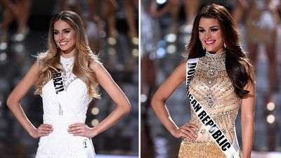 Top 15 contestants Miss Brazil Marthina Brandt andMiss Dominican Republic Clarissa Molina walk on stage at the competition. (Getty)