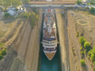 A 22.5-metre-wide cruise liner carrying more than 900 passengers squeezed through the Corinth Canal