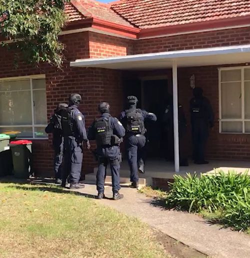 Police storm a home in Mortdale during the raids. Picture: NSW Police