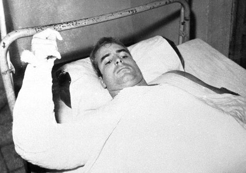 John S. McCain, USN, is shown in this undated photo lying injured in North Vietnam wearing an arm cast. He was a held prisoner during the Vietnam War. (AAP)