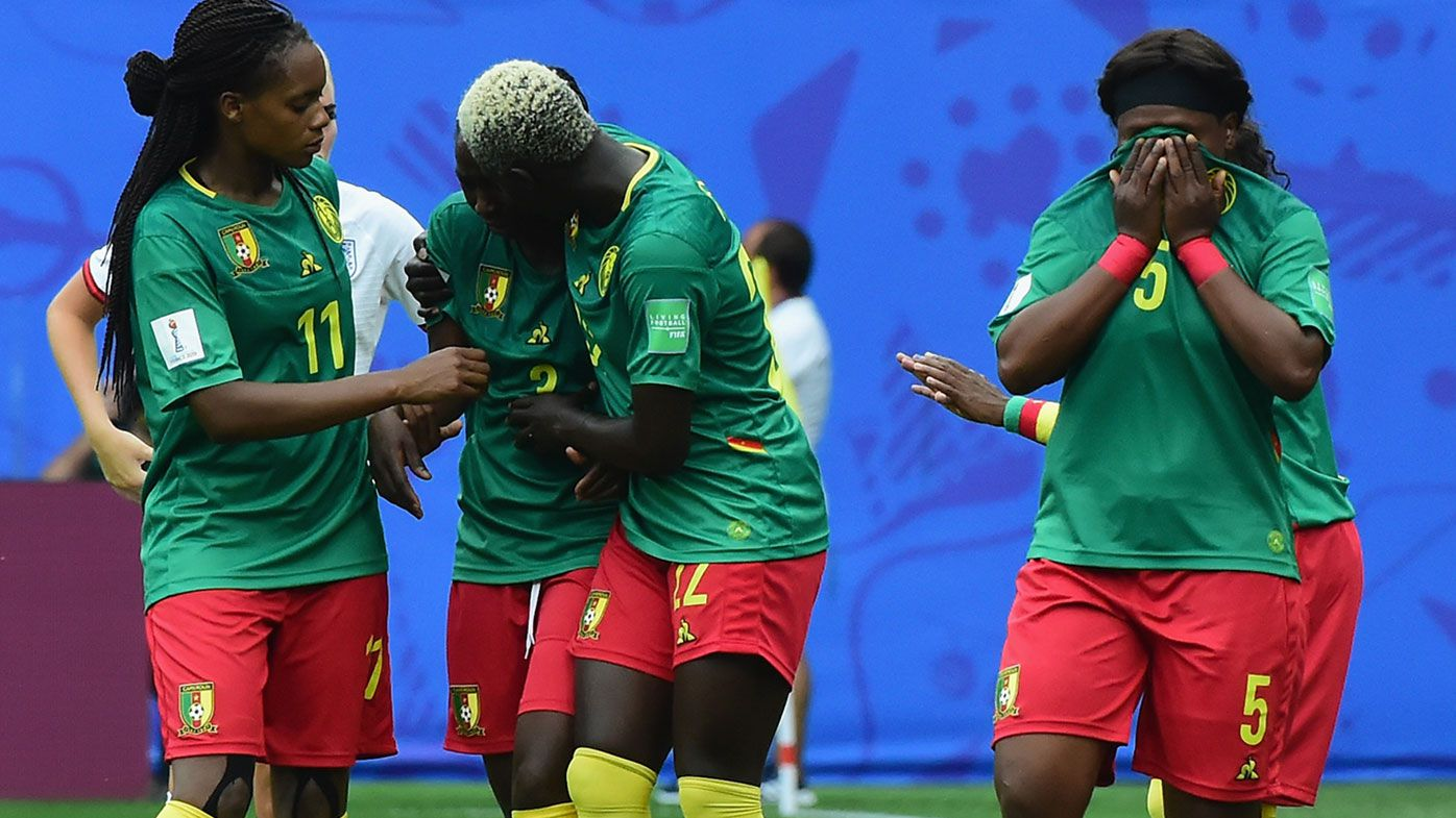 Cameroon players react to a decision during their 3-0 loss to England at the World Cup.