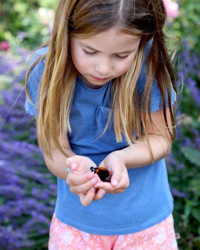 Princess Charlotte cradles butterflies, August 2021