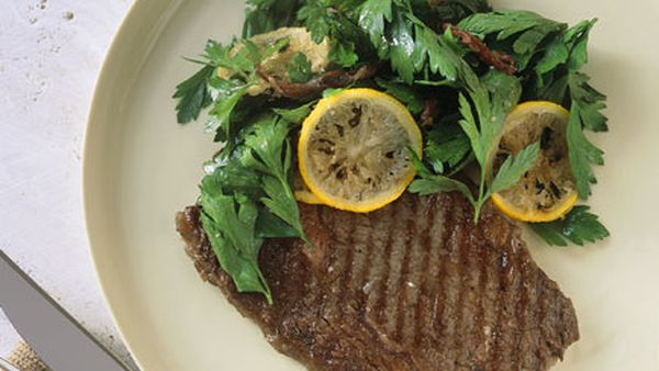 Char-grilled wagyu with parsley and fried lemon salad