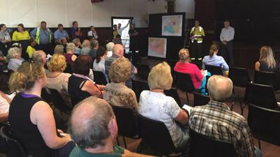 """Northcliffe residents attend a community meeting where they are told their homes are """"undefendable"""". (9NEWS)"""