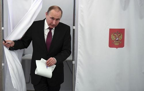 Vladimir Putin is expected to be swept back into power as president for another six years. (AAP)