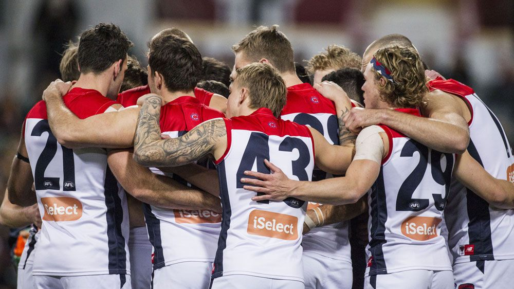 Banged-up Demons beat Eagles in thriller