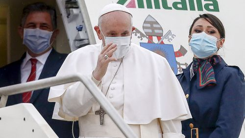 Pope Francis gives his blessing as he prepares to leave from Fiumicino's International airport Leonardo da Vinci, near Rome, for Baghdad, Iraq, Friday, March 5, 2021.