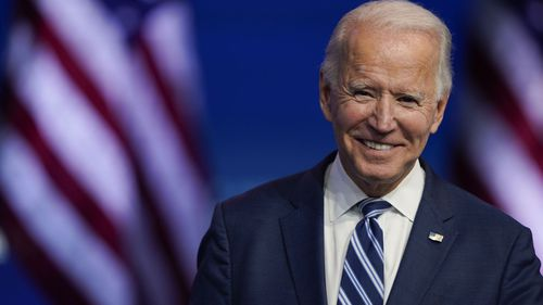 President-elect Joe Biden smiles as he speaks at the Queen Theater in Wilmington, Delaware (Photo: November 10, 2020)
