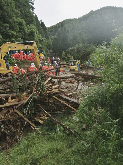 Heavy rain has dumped on southern and central Japan this week, causing floods and mudslides. (Nagasaki Kenou Wide Area Fire Department via AP)