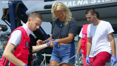 Croatia's coast guard says a British woman has been saved after spending 10 hours in the Adriatic Sea at night after she fell from a cruise ship.