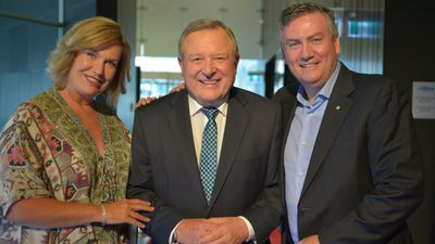 Tracy Grimshaw and Eddie McGuire pose with Hitch.