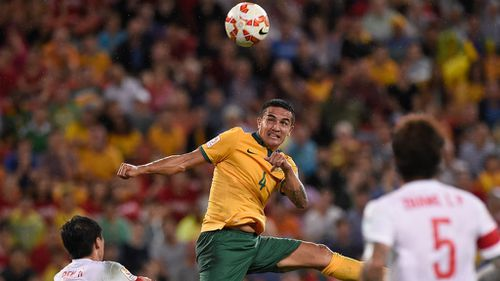 Tim Cahill scores a header for Australia against China in the Asian Cup quarter final in Brisbane. (Getty)