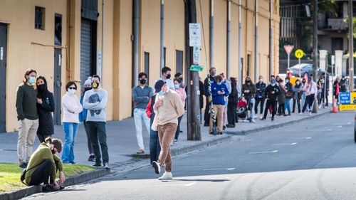 People in St Kilda, Melbourne, waiting to get tested.