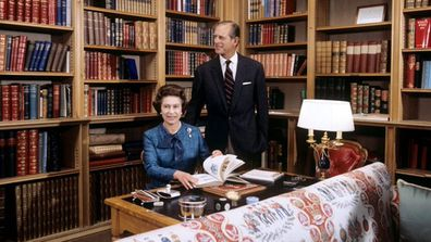 The Queen and The Duke of Edinburgh are pictured in the Library at Balmoral Castle in 1976.