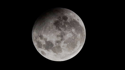 Maximum phase of Penumbral Lunar eclipse at Nehru Planetarium, on January 10, 2020 in Mumbai, India.