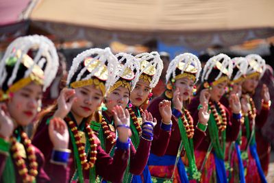 Nepalese people from the ethnic Gurung community dance in the tunes of traditional instruments during a New Year's Eve rally in Kathmandu, Nepal.