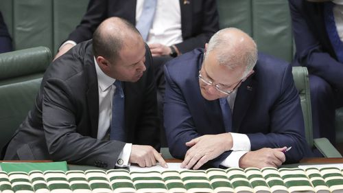 Treasurer Josh Frydenberg and Prime Minister Scott Morrison in parliament this week.