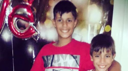 """Jalal (centre)'s mother said she plans to """"fight for her son"""". (9NEWS)"""