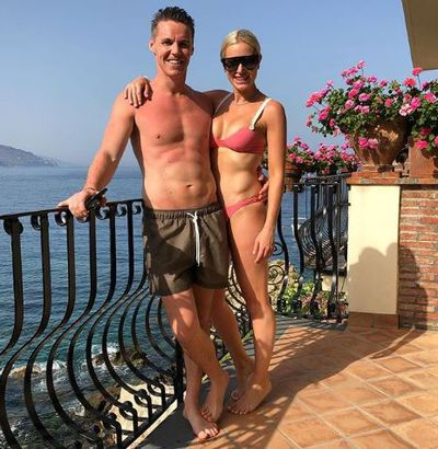 Roxy Jacenko in a sherbet pink bikini with husband Oliver Curtis
