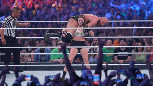WWE newcomer Ronda Rousey putting veteran Triple H into a fireman's carry at Wrestlemania this year. Picture: Supplied