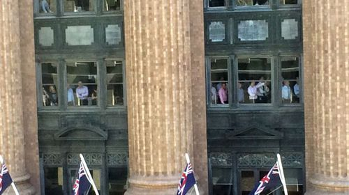Workers inside a Sydney office building near the siege. (supplied)