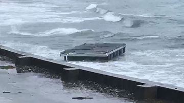 A floating pontoon has snapped off a jetty in Kiama, south of Sydney, amid the wild weather battering NSW.