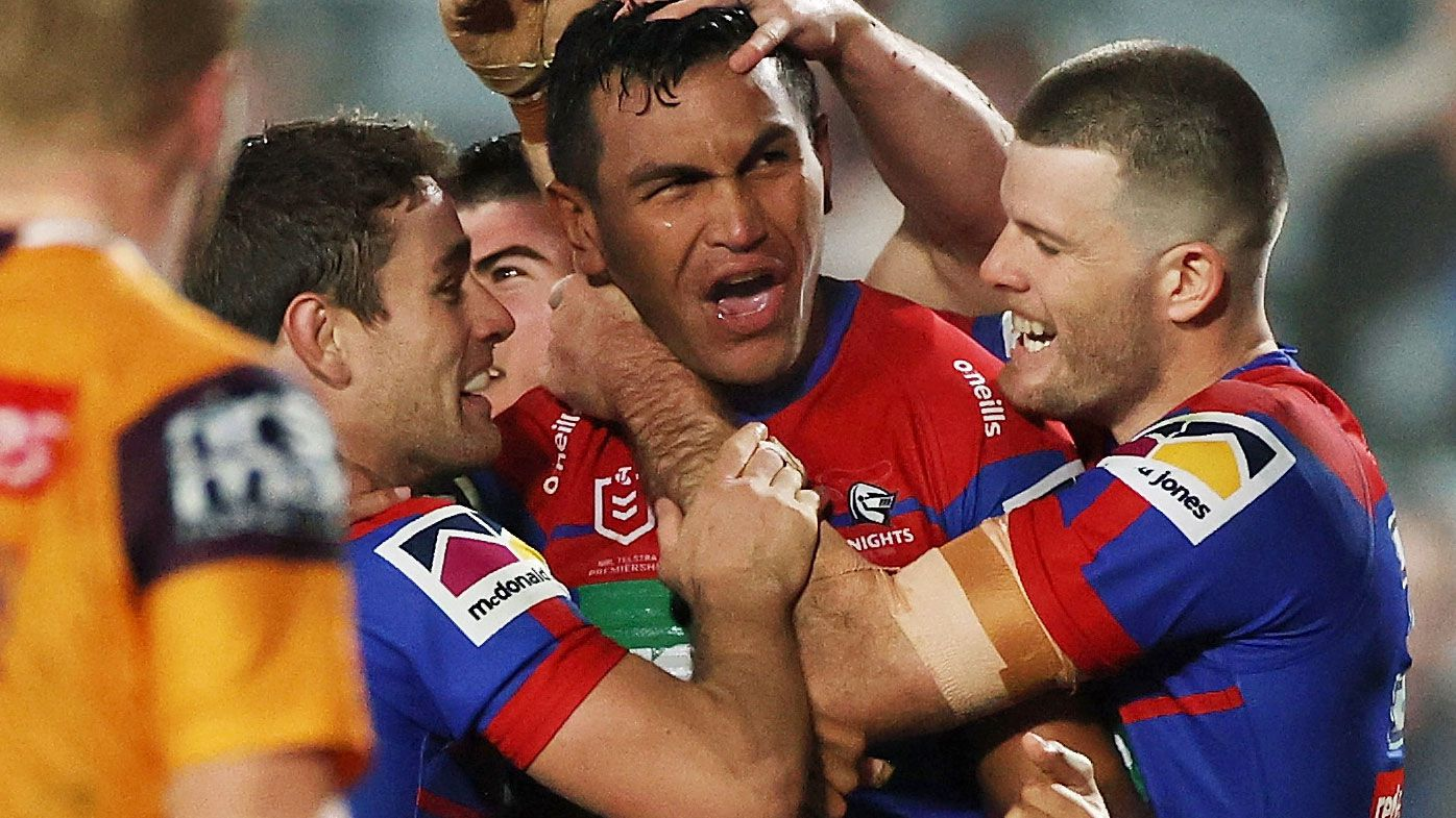 Daniel Saifiti of the Knights celebrates scoring a try