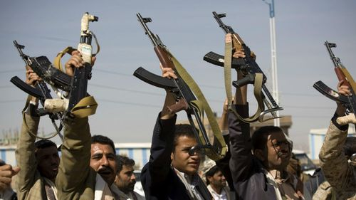 Houthi Shiite Yemeni raise their weapons during  earlier clashes near the presidential palace in Sanaa, Yemen. (AP)