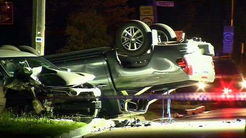 Cars were flipped over in the crash outside the hospital.