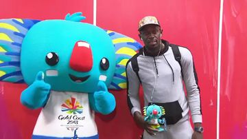 Usain Bolt with Commonwealth Games mascot Borobi on the Gold Coast. (9NEWS)