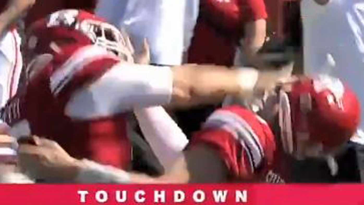 Quarterback inexplicably punched in face by teammate after touchdown